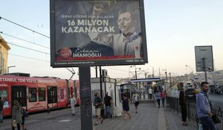 """A poster of Ekrem Imamoglu, secular candidate from the main opposition Republican People's Party, reads """"16 million (city's population) will win,"""" over the Galata Bridge near the Golden Horn in Istanbul, Thursday, June 20, 2019, ahead of the June 23 re-run of Istanbul elections. Imamoglu won the March 31 local elections with a slim majority, but after weeks of recounting requested by President Recep Tayyip Erdogan's ruling party, Turkey's electoral authority annulled the result of the vote, revoked his mandate and ordered the new election. (AP Photo/Burhan Ozbilici)"""