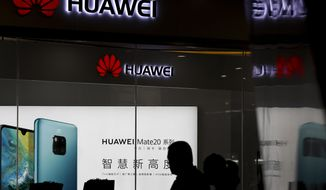 A cybersecurity study of Huawei equipment found that 55% of the Chinese company's hardware devices tested contained at least one backdoor access point. (Associated Press/File)