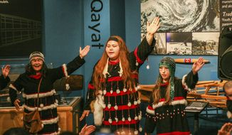 In this Friday, June 14, 2019, photo the Kodiak Alutiiq Dancers perform as part of the dedication and official opening of the Alutiiq Ancestors Memorial in the Alutiiq Museum in Kodiak, Alaska. (Alistair Gardiner/Kodiak Daily Mirror via AP)
