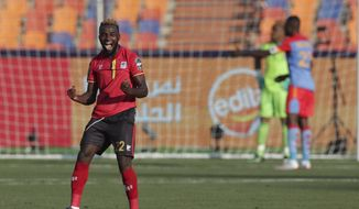 DR Congo's Chancel Mangulu Mbemba celebrates his team's second goal the African Cup of Nations group A soccer match between DR Congo and Uganda at Cairo International Stadium in Cairo, Egypt, Saturday, June 22, 2019. (AP Photo/Hassan Ammar)