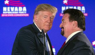 FILE - In this June 23, 2018, file photo, President Donald Trump, left, is greeted by Nevada State GOP Chairman Michael McDonald as he arrives at the podium to speak during the Nevada Republican Party Convention at the Suncoast Hotel and Casino in Las Vegas. Despite a wave of Democratic election wins across Nevada last year, Republicans here are banking on President Donald Trump's enthusiastic supporters, a united Republican organization and the soaring economy to turn the state red in 2020. (AP Photo/L.E. Baskow, File)