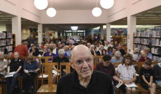 In this Tuesday, June 18, 2019, photo, Bill Weppner, a former NASA flight controller who worked on the space program's Apollo missions, talks about his experiences at the Germantown library in Germantown, Tenn. (Joe Rondone/The Commercial Appeal via AP)