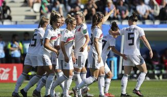 Germany players celebrate after teammate Sara Daebritz scored their side's second goal during the Women's World Cup round of 16 soccer match between Germany and Nigeria at Stade del Alpes in Grenoble, France, Saturday, June 22, 2019. (AP Photo/Laurent Cipriani)