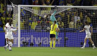 United States goalkeeper Alyssa Naeher punches the ball across the bar during the Women's World Cup Group F soccer match between Sweden and the United States at Stade Océane, in Le Havre, France, Thursday, June 20, 2019. (AP Photo/Alessandra Tarantino)