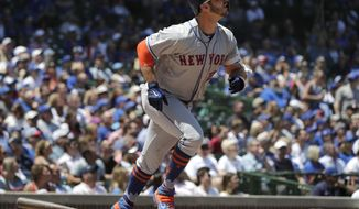 New York Mets' Pete Alonso watches after hitting a solo home run against the Chicago Cubs during the first inning of a baseball game in Chicago, Saturday, June 22, 2019. (AP Photo/Nam Y. Huh)