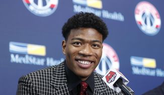 Washington Wizards basketball team introduce Rui Hachimura, the team's first-round pick in the 2019 NBA Draft during a press conference at Capital One Arena in Washington, Friday, June 21, 2019. (AP Photo/Pablo Martinez Monsivais)