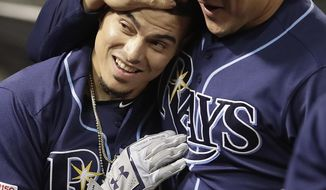 Tampa Bay Rays' Willy Adames, left, is congratulated after hitting a home run against the Oakland Athletics during the sixth inning of a baseball game Friday, June 21, 2019, in Oakland, Calif. (AP Photo/Ben Margot)