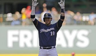 Milwaukee Brewers' Yasmani Grandal gestures after hitting an RBI double during the fourth inning of the team's baseball game against the Cincinnati Reds on Saturday, June 22, 2019, in Milwaukee. (AP Photo/Aaron Gash)