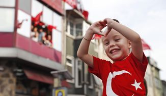 Supporters of Ekrem Imamoglu, candidate of the secular opposition Republican People's Party, or CHP, cheer during his speech a rally in Istanbul, Friday, June 21, 2019, ahead of June 23 re-run of Istanbul elections.The 49-year-old candidate won the March 31 local elections with a slim majority, but after weeks of recounting requested by the ruling party, Turkey's electoral authority annulled the result of the vote, revoked his mandate and ordered the new election.(AP Photo/Lefteris Pitarakis)
