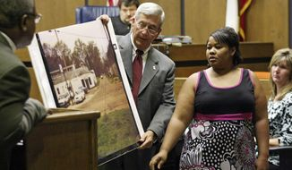 FILE -  In this June 14, 2010 file photograph, Clemmie Flemming points out to prosecutor Doug Evans, center, where she spotted Curtis Giovanni Flowers on the morning of four slayings at Tardy Furniture in Greenwood, Miss. Evans, a Mississippi prosecutor who has tried the same man six times in a death penalty case now will decide whether to seek a seventh trial after the U.S. Supreme Court found racial bias in jury selection. (Taylor Kuykendall/The Commonwealth via AP, File)