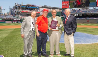 """Ted Leonsis (second from right), president and CEO of Monumental Sports and Entertainment, picks up the Washington Capitals' """"Team of Distinction"""" award from the D.C. Sports Hall of Fame at a ceremony at Nationals Park on Sunday, June 24, 2019. Leonsis' company owns the Capitals, Washington Wizards and Washington Mystics. (Photo courtesy of Washington Nationals Baseball Club)"""