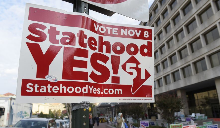 Signs supporting D.C. statehood are on display outside an early voting place on in Washington, Thursday, Nov. 3, 2016. (AP Photo/Susan Walsh) **FILE**