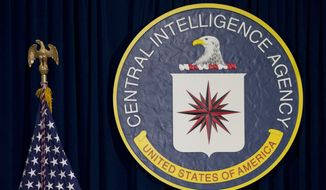 This April 13, 2016 file photo shows the seal of the Central Intelligence Agency at CIA headquarters in Langley, Va. James Pars, a CIA intelligence officer, says his career was derailed after he complained that his boss at a base in a conflict zone repeatedly ordered personnel to travel through dangerous areas on non-essential trips to shop and buy food. Pars filed his suit in December in federal court in Washington, D.C., against the CIA and former CIA Director John Brennan. Details of the suit were highlighted in a report issued Thursday, Aug. 24, 2017, by the Project On Government Oversight, an independent watchdog that probes government corruption and misconduct and has called on Congress to strengthen whistleblower protections for employees at U.S. intelligence agencies. (AP Photo/Carolyn Kaster, File)