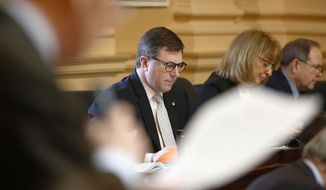 Virginia Del. Chris Peace, R-Hanover, listens to debate on the floor of the House during the session at the Capitol in Richmond, Va., Friday, Feb. 15, 2019. (AP Photo/Steve Helber)