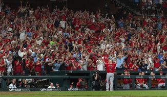 Los Angeles Angels' Albert Pujols waves to the crowd for a curtain call after his last at bat of the night during the ninth inning of a baseball game against the St. Louis Cardinals, Sunday, June 23, 2019, in St. Louis. (AP Photo/L.G. Patterson)