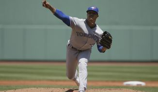 Toronto Blue Jays' Marcus Stroman delivers a pitch against the Boston Red Sox in the first inning of a baseball game in Boston, Sunday, June 23, 2019. (AP Photo/Steven Senne)