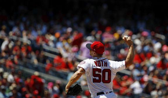 Washington Nationals starting pitcher Austin Voth throws to the Atlanta Braves in the third inning of a baseball game, Sunday, June 23, 2019, in Washington. (AP Photo/Patrick Semansky) ** FILE **