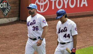 New York Mets' Jason Vargas, right, is accompanied by manager Mickey Callaway as he leaves a baseball game during the fourth inning against the St. Louis Cardinals at Citi Field, Sunday, June 16, 2019, in New York. (AP Photo/Seth Wenig) ** FILE **