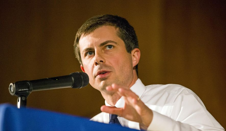 Democratic presidential candidate and South Bend Mayor Pete Buttigieg answers questions during a town hall community meeting, Sunday, June 23, 2019, at Washington High School in South Bend, Ind. Buttigieg faced criticism from angry black residents at the emotional town hall meeting, a week after a white police officer fatally shot a black man in the city. (Robert Franklin/South Bend Tribune via AP)