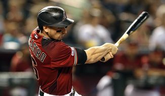 Arizona Diamondbacks' Tim Locastro hits an RBI single against the San Francisco Giants in the third inning during a baseball game, Sunday, June 23, 2019, in Phoenix. (AP Photo/Rick Scuteri)