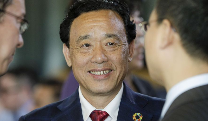 Qu Dongyu from China, one of the candidates for the Director-General position of the FAO (UN Food and Agriculture Organization), arrives to address a plenary meeting of the 41st Session of the Conference, at the FAO headquarters in Rome, Saturday, June 22, 2019. The new FAO Director-General will be voted on Sunday. (AP Photo/Andrew Medichini) **FILE**