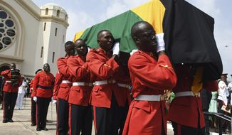 The honor guard carries the casket of Jamaica's former Prime Minister Edward Seaga during his funeral at National Heroes Park in Kingston, Jamaica, Sunday, June 23, 2019. Seaga served as prime minister from 1980 until 1989 and was the only remaining member of the generation of leaders who drafted the constitution when the island gained independence from Britain in 1962. He died in Florida on May 28 on his 89th birthday. (AP Photo/Collin Reid)