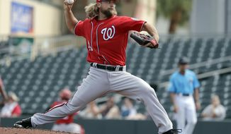 FILE - In this March 1, 2019, file photo, Washington Nationals pitcher Trevor Rosenthal throws during the third inning of an exhibition spring training baseball game against the Miami Marlins, in Jupiter, Fla. Rosenthal has been released by the Nationals, who ran out patience waiting for the reliever to return to form. Rosenthal ends his three-month stint in Washington with a 0-1 record and an unsightly 22.74 ERA. The Nationals made the move Sunday, June 23, 2019 less than 24 hours after he walked all three batters he faced in a 13-9 loss to Atlanta. (AP Photo/Jeff Roberson, File)