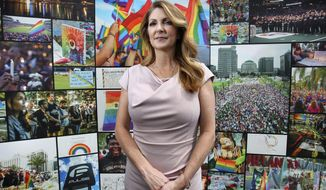 Barbara Poma, CEO of the onePULSE Foundation, in front of the Pulse Interim Memorial located at the Pulse nightclub site south of downtown Orlando, Fla., on June 6, 2019. (Joe Burbank/Orlando Sentinel via AP)