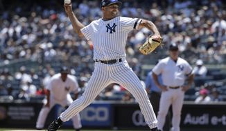Former New York Yankee Mariano Rivera pitches during the Old Timer's Day game at Yankee Stadium, Sunday, June 23, 2019, in New York. (AP Photo/Seth Wenig)