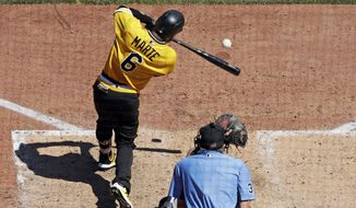 Pittsburgh Pirates' Starling Marte (6) drives in a run with a sacrifice fly to right field off San Diego Padres starting pitcher Joey Lucchesi during the fifth inning of a baseball game in Pittsburgh, Sunday, June 23, 2019. (AP Photo/Gene J. Puskar)