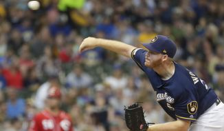 Milwaukee Brewers starting pitcher Brandon Woodruff throws during the first inning of a baseball game against the Cincinnati Reds Sunday, June 23, 2019, in Milwaukee. (AP Photo/Morry Gash)