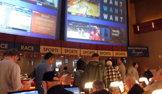 In this March 21, 2019, file photo, gamblers line up to place bets on the NCAA men's college basketball tournament at the Borgata casino in Atlantic City N.J. This is the first March Madness tournament since legal gambling expanded last year in the U.S.  The spread of legalized sports betting is largely following regional boundaries. Lawmakers across the Northeast and upper Midwest have generally approved it or are still considering doing so this year. But in the Deep South and far West, fewer states are rushing in a year after the US Supreme Court cleared the way for legal sports betting nationally. (AP Photo/Wayne Parry, File) **FILE**