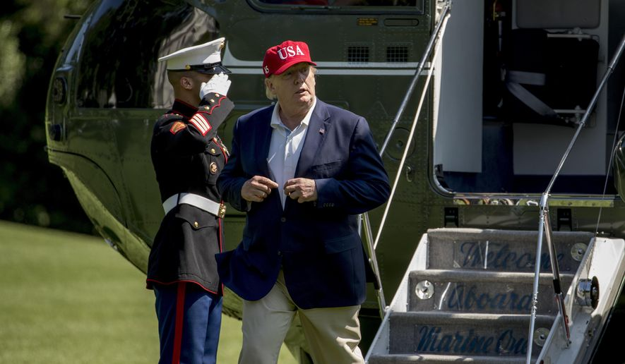 President Donald Trump arrives to the South Lawn of the White House in Washington, Sunday, June 23, 2019, after traveling from Trump National Golf Club in Sterling, Va. (AP Photo/Andrew Harnik)