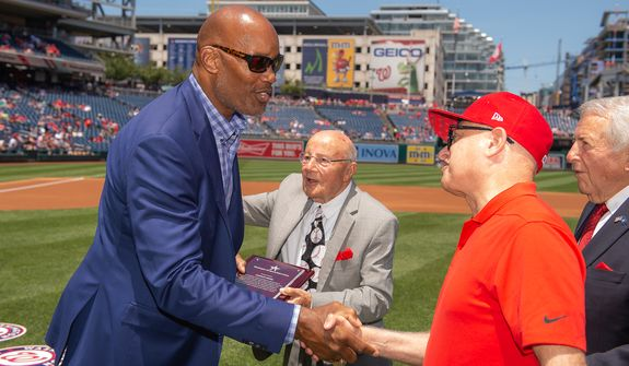 The D.C. Sports Hall of Fame class of 2019, including Redskins great Charles Mann, left, is inducted in a special ceremony on Sunday, June 23, 2019, at Nationals Park. (Paul Kim/Washington Nationals)