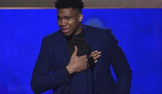 NBA player Giannis Antetokounmpo, of the Milwaukee Bucks, reacts as he accepts the most valuable player award at the NBA Awards on Monday, June 24, 2019, at the Barker Hangar in Santa Monica, Calif. (Photo by Richard Shotwell/Invision/AP) ** FILE **