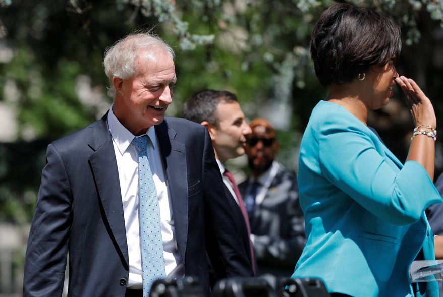 In this May 31, 2019, photo, Washington Metropolitan Area Transit Authority Chair and D.C. Council Member Jack Evans joins D.C., Mayor Muriel Bowser, right, at the podium during a news conference announcing a dedicated bus lane in downtown Washington. (AP Photo/Pablo Martinez Monsivais) **FILE**