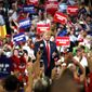 The focus of the crowd: President Trump pumps his fist during his reelection kickoff rally in Orlando, Florida, last week. (Associated Press)