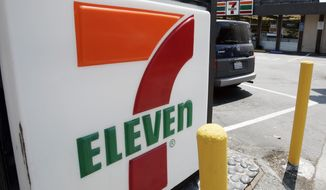"""FILE - In this July 1, 2008 file photo, a 7-Eleven is shown in Palo Alto, Calif. The convenience-store chain is launching a service that lets customers order everything from its trademark frozen drink to a battery charger and have it delivered to a public place like a park or a beach.  The retailer told The Associated Press that more than 2,000 7-Eleven """"hot spots"""" including New York's Central Park and Venice Beach in Los Angeles will be working starting Monday, June 24, 2019.  (AP Photo/Paul Sakuma, File)"""