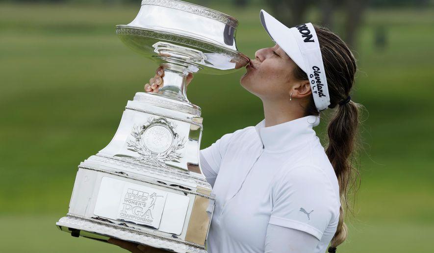 Hannah Green, of Australia, kisses the trophy after winning the KPMG Women's PGA Championship golf tournament, Sunday, June 23, 2019, in Chaska, Minn. (AP Photo/Charlie Neibergall)