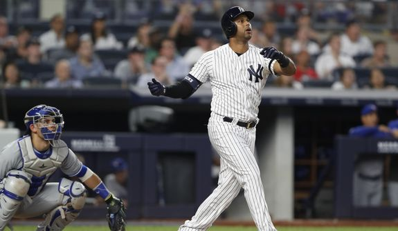 Toronto Blue Jays catcher Luke Maile, left, watches from behind the plate as New York Yankees' Aaron Hicks reacts after hitting a three-run home run during the fifth inning of a baseball game, Monday, June 24, 2019, in New York. (AP Photo/Kathy Willens) **FILE**