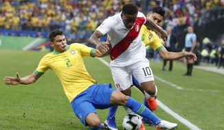 Brazil's Thiago Silva, let, and Peru's Jefferson Farfan battle for the ball during a Copa America Group A soccer match at the Arena Corinthians in Sao Paulo, Brazil, Saturday, June 22, 2019. (AP Photo/Victor R. Caivano)