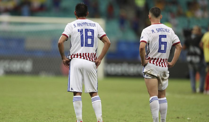 Paraguay's Santiago Arzamendia, left, and Richard Sanchez stands on the pitch at the end of a Copa America Group B soccer match at the Arena Fonte Nova in Salvador, Brazil, Sunday, June 23, 2019. (AP Photo/Natacha Pisarenko)