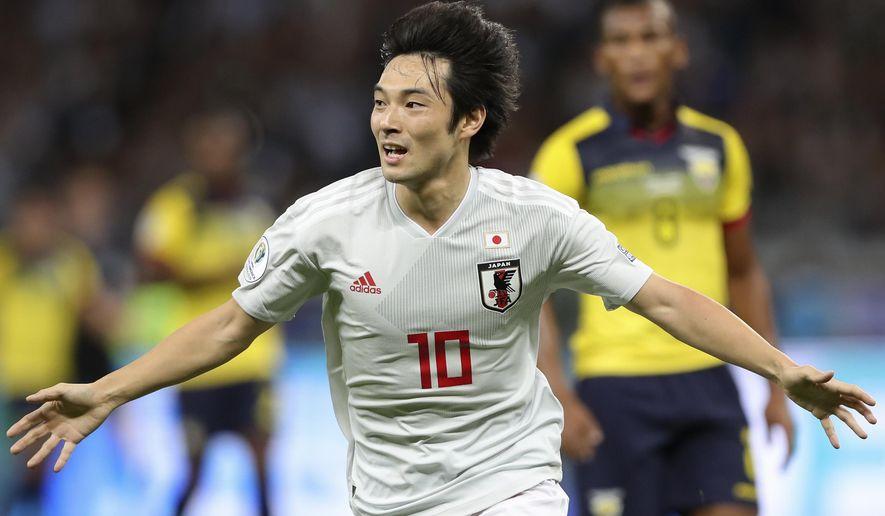 Japan's Shoya Nakajima celebrates after scoring his side's first goal against Ecuador during a Copa America Group C soccer match at the Mineirao stadium in Belo Horizonte, Brazil, Monday, June 24, 2019. (AP Photo/Ricardo Mazalan)