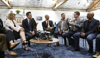 FILE - In this May 14, 2019, file photo, Jim Holifield, second from right, who is semi-retired and runs his own part-time consulting firm, describes the problems of getting health insurance to California Gov. Gavin Newsom, second from left, during a discussion about health care with small business owners, in Sacramento, Calif. The California Legislature approved a bill, Monday, June 24, 2019, that taxes people who refuse to buy health insurance and uses the money to help small business owners and others pay for health insurance. (AP Photo/Rich Pedroncelli, File)