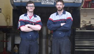 In this  May 8, 2019 photo, brothers Tony, left, and Tyler Baumann stand in their shop at Old Town Garage in Mankato, Minn. The pair resurrected the historic building, which was originally built as a Texaco gas station. (Pat Christman/The Free Press via AP)
