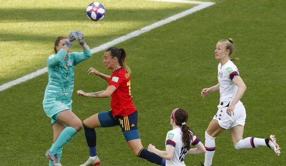 United States goalkeeper Alyssa Naeher, left, makes a save in front of Spain's Virginia Torrecilla, second left, during the Women's World Cup round of 16 soccer match between Spain and United States at Stade Auguste-Delaune in Reims, France, Monday, June 24, 2019. (AP Photo/Thibault Camus)