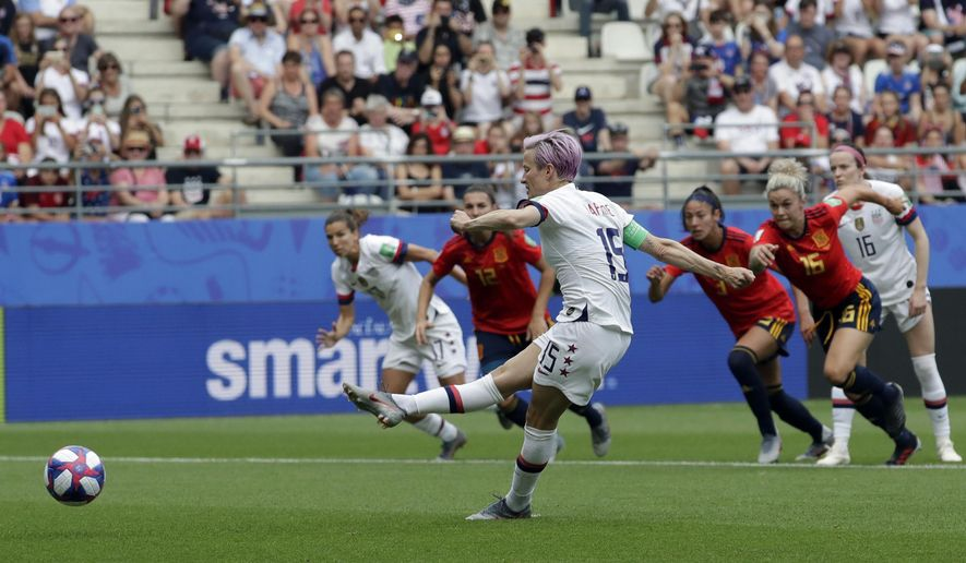 United States' Megan Rapinoe scores a scores the opening goal from a penalty spot during the Women's World Cup round of 16 soccer match between Spain and US at the Stade Auguste-Delaune in Reims, France, Monday, June 24, 2019. (AP Photo/Alessandra Tarantino) ** FILE **