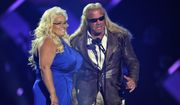"""In this Wednesday, June 5, 2013, file photo, Duane """"Dog""""Chapman, right, and Beth Chapman present the award for CMT performance of the year at the CMT Music Awards at Bridgestone Arena in Nashville, Tenn. Beth Chapman is in a medically induced coma in the intensive care unit of Queen's Medical Center in Honolulu, The Honolulu Star-Advertiser reported Sunday, June 23, 2019. Chapman was diagnosed with lung cancer in September 2017 and said in November 2018 that the cancer had returned despite surgery. (Photo by Donn Jones/Invision/AP, File)"""