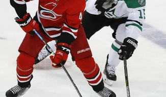 FILE - In this Feb. 23, 2019, file photo, Carolina Hurricanes defenseman Calvin de Haan (44) controls the puck next to Dallas Stars left wing Blake Comeau (15) during the third period of an NHL hockey game in Dallas. The Chicago Blackhawks have acquired de Haan in a trade with the Hurricanes.The Blackhawks also received minor league forward Aleksi Saarela from the Hurricanes in exchange for defenseman Gustav Forsling and goaltender Anton Forsberg. (AP Photo/LM Otero, File)