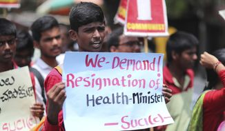 Activists of Socialist Unity Centre of India (Communist) shout slogans condemning deaths of more than 100 children in an encephalitis outbreak this month in eastern Bihar state, during a protest in Hyderabad, India, Monday, June 24, 2019. (AP Photo/Mahesh Kumar A.)